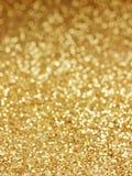 Золотая предпосылка defocused абстрактных светов Стоковые Изображения RF