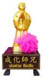 Золотая статуя китайского бога изолированного на белой предпосылке Стоковое Изображение RF