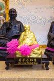 Золотая статуя китайского бога Стоковые Фото