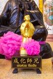 Золотая статуя китайского бога Стоковые Изображения