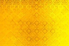 Золотая текстура предпосылки стиля стекла окна желтого цвета зеркала тайская Стоковые Изображения
