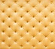 Золотая текстура ткани софы цвета Стоковые Изображения