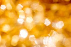 Золотистая предпосылка Кристмас Bokeh Яркий блеск праздника золота накаляя абстрактный Defocused Стоковое фото RF