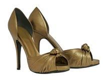 золотистые ботинки стоковая фотография
