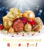 Золотистые украшения рождества Стоковая Фотография