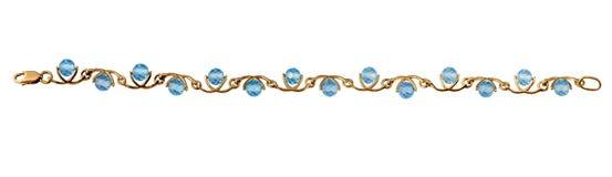 Золотистый браслет ювелирных изделий с голубым topaz Стоковые Изображения RF