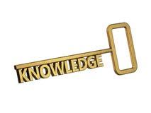 Золотистый ключ с знанием слова Стоковая Фотография