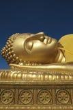 Золотое возлежа небо Songkla Будды и Dhammajak голубое Стоковые Фото