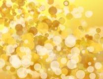 Золотое и белое bokeh стоковое изображение
