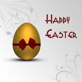 Золотое пасхальное яйцо с смычком Стоковое Фото
