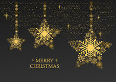 Золотое рождество играет главные роли с снежинками на черной предпосылке Стоковое Изображение RF