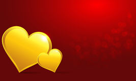 Золотое сердце на красной предпосылке Стоковые Фото