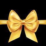 Золотое украшение смычка на черноте Стоковые Фото