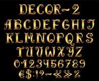 Золотой английский алфавит с номерами и символами. Стоковое фото RF
