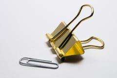 Золотой зажим связывателя Стоковое Фото