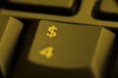 Золотой ключ $ в клавиатуре стоковые фотографии rf