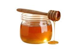 Золотой мед изолированный на белой предпосылке Стоковое Фото