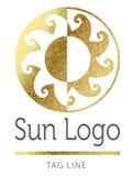 Золотой логотип солнца Стоковое фото RF