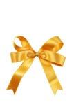 Золотой смычок изолированный на белой предпосылке Стоковая Фотография