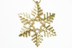 Золотой хлопь снега на белой предпосылке Стоковые Изображения RF