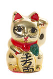 Золотой японский кот керамический на белой предпосылке Стоковое Фото