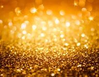 Золотой яркий блеск и звезды для предпосылки рождества Стоковые Изображения RF
