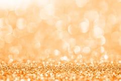 Золотой яркий блеск для абстрактной предпосылки стоковое фото