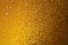 Золотой яркий блеск Bokeh в переносе наклона Стоковая Фотография RF