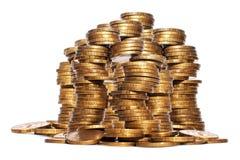 Золото возвышается золотые монетки Стоковые Изображения