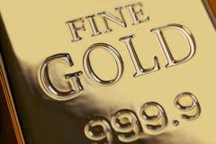 Золото в слитках и финансовая концепция стоковые изображения