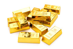 Золото в слитках на белизне Стоковая Фотография