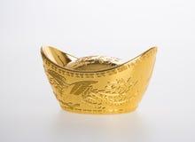 Золото или китайские символы середины золотого ингота богатства и процветания Стоковое Изображение