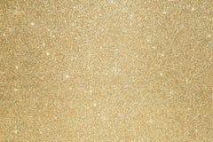 Золото предпосылки золота искры яркого блеска Defocused абстрактное освещает на предпосылке стоковые изображения rf
