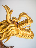 Золото цвета дракона китайское сделанное от деревянного фото Стоковые Фото