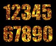 Золото чисел на черноте предпосылки Стоковые Изображения