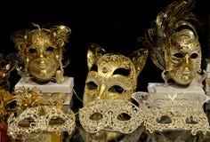 Золотые венецианские маски Стоковые Изображения