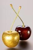 Золотые вишни на серой предпосылке Стоковое Изображение