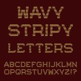 Золотые волнистые линии письма Stripy шрифт Стоковые Изображения RF