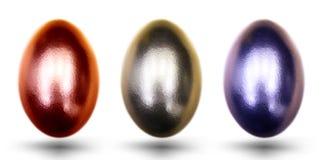 Золотые голубые и прочитанные яичка для пасхи на белой предпосылке Стоковое Изображение RF