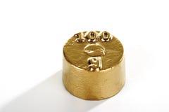 Золотые 100 граммов веса Стоковые Изображения RF
