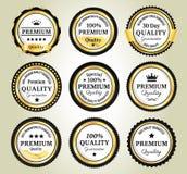 Золотые значки качественной гарантии Стоковое Изображение RF