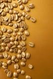 Золотые кофейные зерна Стоковое Изображение RF