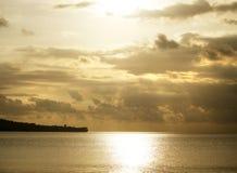 Золотые море и облака Стоковые Фото