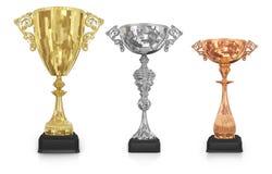 Золотые, серебряные и бронзовые трофеи стоковое изображение rf