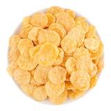 Золотые хлопья мозоли в белом изолированном шаре, взгляд сверху хлопья Стоковое фото RF