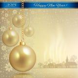 Золотые шарики рождества с голубой лентой Стоковое Фото