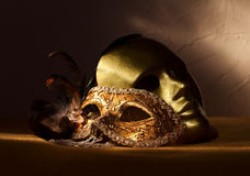 2 золотых венецианских маски Стоковая Фотография