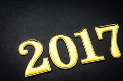 2017 золотых чисел на черноте Стоковое Изображение RF