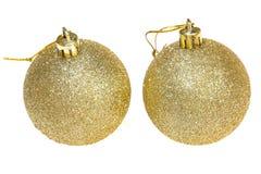 2 золотых шарика украшения рождества Стоковое Фото