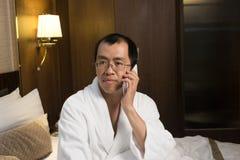 Зрелый азиатский человек в купальном халате стоковое фото rf